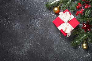 Red present box and decorations on