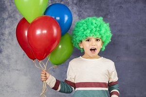 Little boy with a green wig