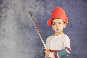 Little kid with a  pirate hat