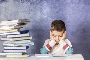 Little kid stressed doing homework