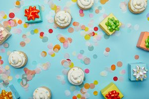 Top view of tasty cupcakes, confetti