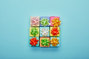 Top view of colorful gifts with bows