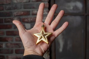 Golden five pointed star decoration