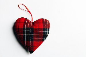 The checkered red fabric heart in th