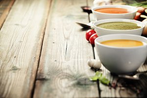 Variety of cream soups over old wood