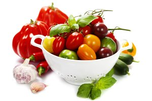 Assorted tomatoes and vegetables in