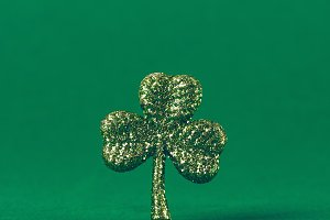 Glitter shamrock on green paper drop