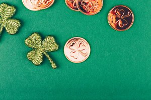 Glitter shamrocks and golden coins