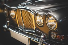 Grille and headlamps of a Jaguar car by  in Transportation