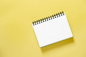 Spiral book yellow background Paper