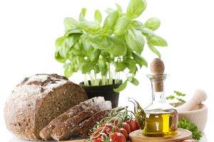 Bread, herbs, olive oil and vegetabl
