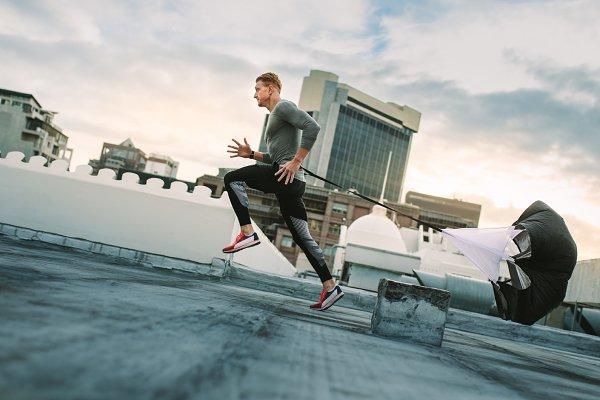 Athlete training on rooftop running…