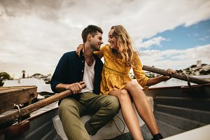 Man and woman sitting in a boat