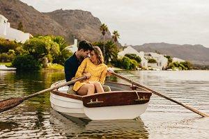 Couple having fun sitting in a boat
