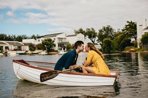 Romantic couple sitting in a boat
