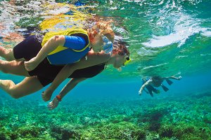 Family snorkeling in tropical sea