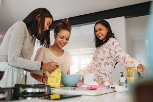 Girls having fun cooking together