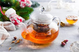 Glass teapot with flowers tied tea