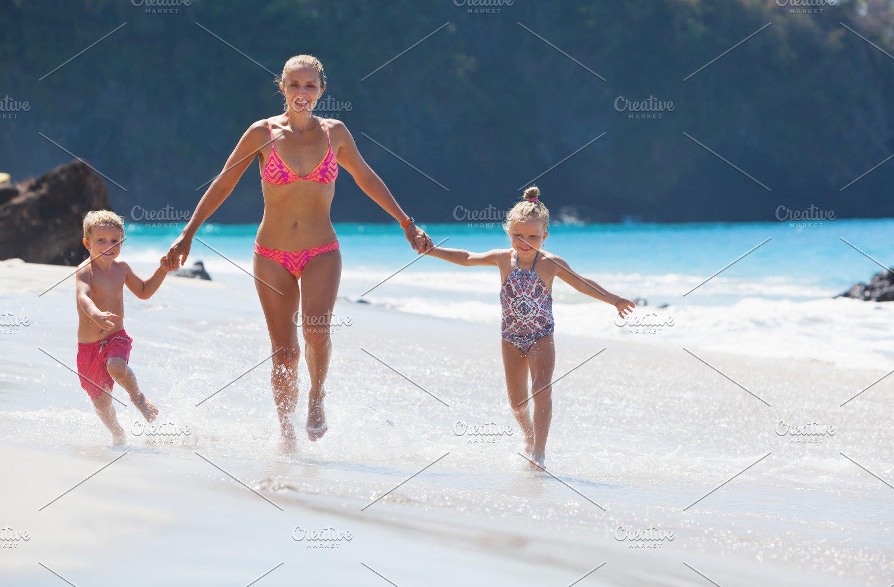 Happy family run by white beach