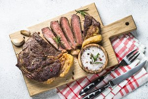 Grilled beef steak ribeye on white.