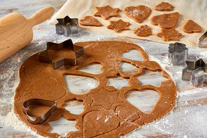 Raw gingerbread dough rolled out on