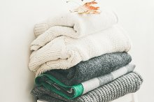 Pile of warm winter sweaters and by  in Abstract