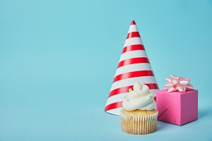 Red white party hat, pink gift box a