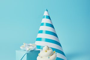 party hat, gift box and tasty cupcak