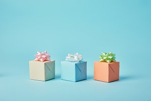 Different gifts with bows on blue ba