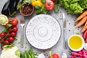 Empty plate and fresh vegetables