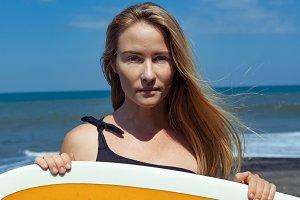 Surfer girl on tropical beach