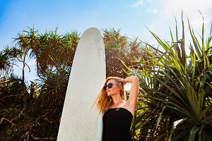 Surfer girl on tropical beach