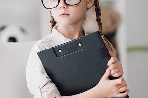 little child in eyeglasses