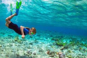 Child dive underwater