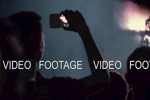 Music fan shooting cellphone video