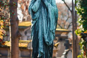 Grieving statue in an old cemetery