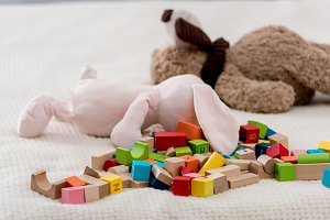 Colourful toy cubes and teddy bears