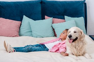 Girl spending time with dog at home