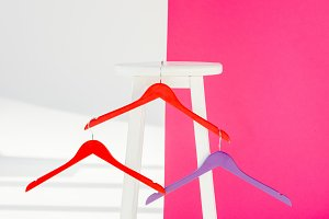 multicolored painted hangers with wh