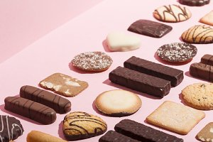 Assortment of cookies on pink backgr