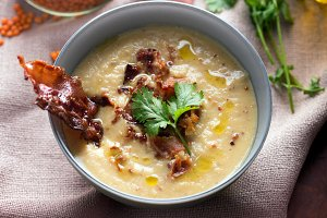 Lentil soup puree with bacon in a