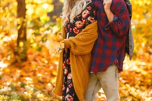 Photo of embracing couple on walk in