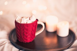 Knitted cup with candles