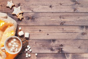 Wooden background with cup of cocoa