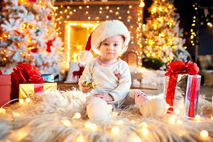 Toddler in santa claus hat in