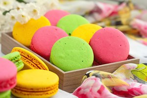 Colorful macaroons on wooden table