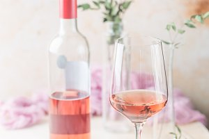 Glass and bottle of rose wine