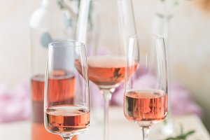 Glasses and bottle of rose wine