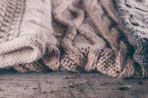 Three knit sweaters