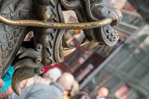 Rubbing head of statue brings good